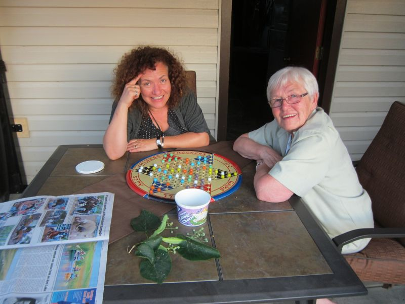 Marilyn and her mom playing chinese checkers
